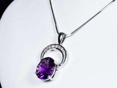 OOOO La La- a14.5 carat fantasy cut oval amethyst